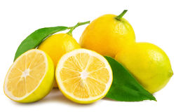 Three half lemons and whole on a white background.  Royalty Free Stock Photography