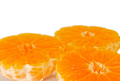 Three half mandarins without peel Royalty Free Stock Photo
