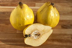 Three and half organic quinces Royalty Free Stock Photo