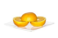 Three half pieces of an orange Stock Photos