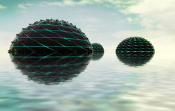 Three half spheres composition in water with sky. Abstract 3D shapes as three half spiky spheres composition in water with sky Royalty Free Stock Photos