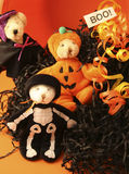Three Halloween Bears. 3 small bears dressed in halloween costume with black raffia and a boo sign royalty free stock photography