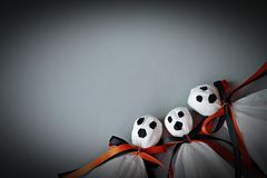 Three halloween ghosts DIY made from white tissue paper, black and orange ribbon on gray background Royalty Free Stock Photos