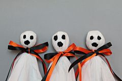 Three halloween ghosts on gray background Royalty Free Stock Image