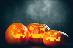 Three halloween Jack O` Lantern pumpkins Stock Photo