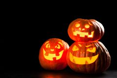Three halloween Jack O` Lantern pumpkins Stock Image