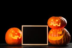 Three halloween Jack O` Lantern pumpkins Royalty Free Stock Photo