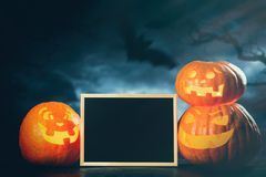 Three halloween Jack O` Lantern pumpkins Stock Images