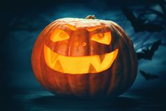 Three halloween Jack O` Lantern pumpkins Royalty Free Stock Photos