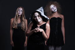 Three halloween personages over dark background Stock Photography