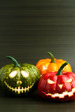 Three Halloween pumpkin with scary face Stock Images