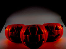 Three Halloween pumpkins in the dark Royalty Free Stock Photos