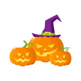 Three Hallowing jack o lanterns, pumpkins in pointed witch hat Stock Images