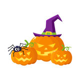 Three Hallowing jack o lanterns, pumpkins in pointed witch hat Stock Photo
