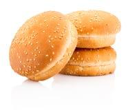 Three hamburger buns with sesame isolated on white background. Three hamburger buns with sesame isolated on a white background royalty free stock photo