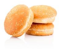 Three hamburger buns with sesame isolated on white background. Three hamburger buns with sesame isolated on a white background stock photos