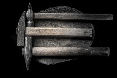 Three hammers with wooden handle with many iron hobnails on the wooden stub. brutal male style Stock Image