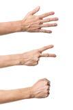 Three hand gestures. Rock Paper Scissors game. On white Stock Photo