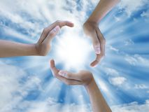 Three hand holding the sun Royalty Free Stock Photography