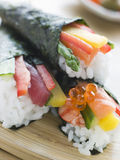 Three hand Rolled Seafood and Vegetable Sushi Royalty Free Stock Images