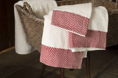 Three Hand Towels Hanging From Basket on Wooden Stool royalty free stock photo