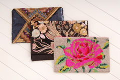 Three handbags with embroidery, clutchs Stock Photos