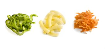 Three handfuls of julienne slices of green pepper, potato and carrot royalty free stock image