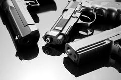 Three handguns Stock Image
