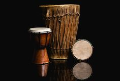 Three handmade Djembe drums isolated on black Stock Photography