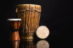 Three handmade Djembe drums isolated on black Stock Photo