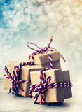 Three handmade gift boxes in shiny colour christmas background Royalty Free Stock Image