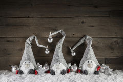 Three handmade gimps on wooden background for christmas decorati Royalty Free Stock Images