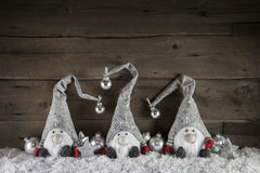Three handmade gimps on wooden background for christmas decorati Stock Image