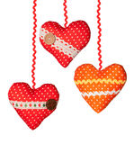 Three Handmade hearts with polka dots ribbons buttons Royalty Free Stock Photos