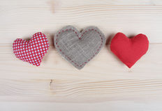 Three handmade hearts on wooden background Stock Photography