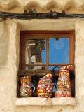 Three handmade jugs in a window Royalty Free Stock Photos