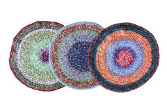 Three handmade knitted rugs Royalty Free Stock Images