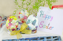 Three handpainted decoupage Easter eggs on stands Royalty Free Stock Images