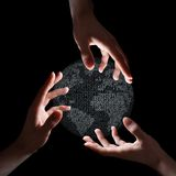 Three hands around binary earth stock photography