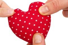 Three hands holding heart Stock Photo
