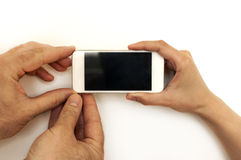Three hands,man and female, holding mobile phone,smartphone Stock Photos