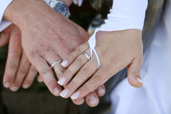 Three hands and only two rings. Stock Photography