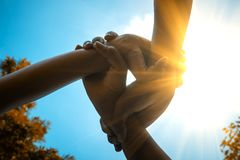 Three hands were a collaboration concept of teamwork. With sunbeam and vivid color style Royalty Free Stock Photo