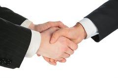 Three handshaking hands Royalty Free Stock Image