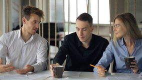 Three handsome persons discuss working project during coffee break. stock video footage