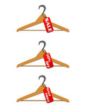 Three hangers with sale and discount tags Stock Images