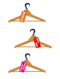 Three hangers with sale and discount tags Royalty Free Stock Photo