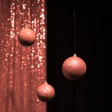 Three hanging Christmas balls in the color of living coral royalty free stock photos