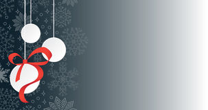Three hanging Christmas balls on snowing background and copy space Stock Images