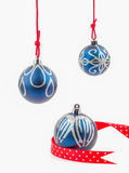 Three hanging Christmas baubles isolated on white Royalty Free Stock Photos